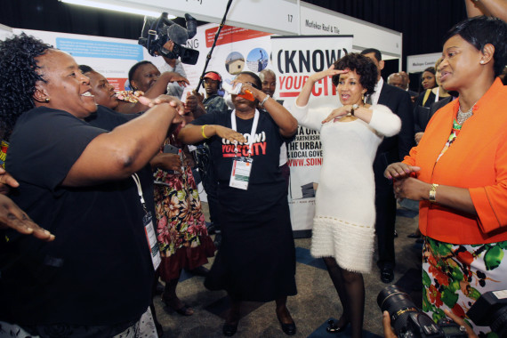 FEDUP members welcome Minister Lindiwe Sisulu and Deputy Minister Zoe Kota-Fredericks at the SDI Exhibition booth