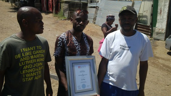 Sizwe with Langrug commnuity leaders Trevor Masiy and Alfred Ratana