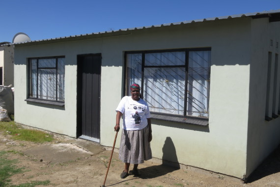 Beauty Nkosi infront of her Federation house