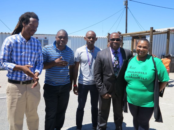 Nkokheli Ncambele (second from left) with fellow ISN co-ordinators Mzwanele Zulu and Melanie Manuel (far left and right), CORC technical support, Sizwe Mxobo (centre) and Western Cape MEC for Human Settlements.