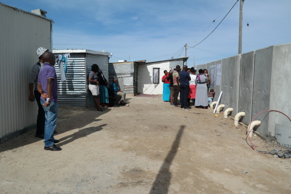 Tambo Square community use back of newly installed toilets for mapping workshop to plan further upgrading initiatives in their settlement.