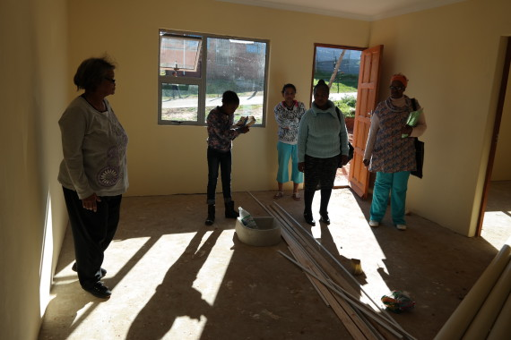 Dolly and FEDUP Coordinators inspect a near-complete FEDUP house
