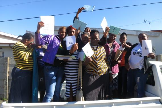 Nomvula, transporting Mpumalanga savings members in her white pickup