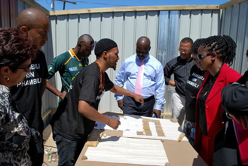 Deputy Minister of Human Settlements, Ms. Kota-Fredericks, visits the newly re-blocked Mtshini Wam in 2012