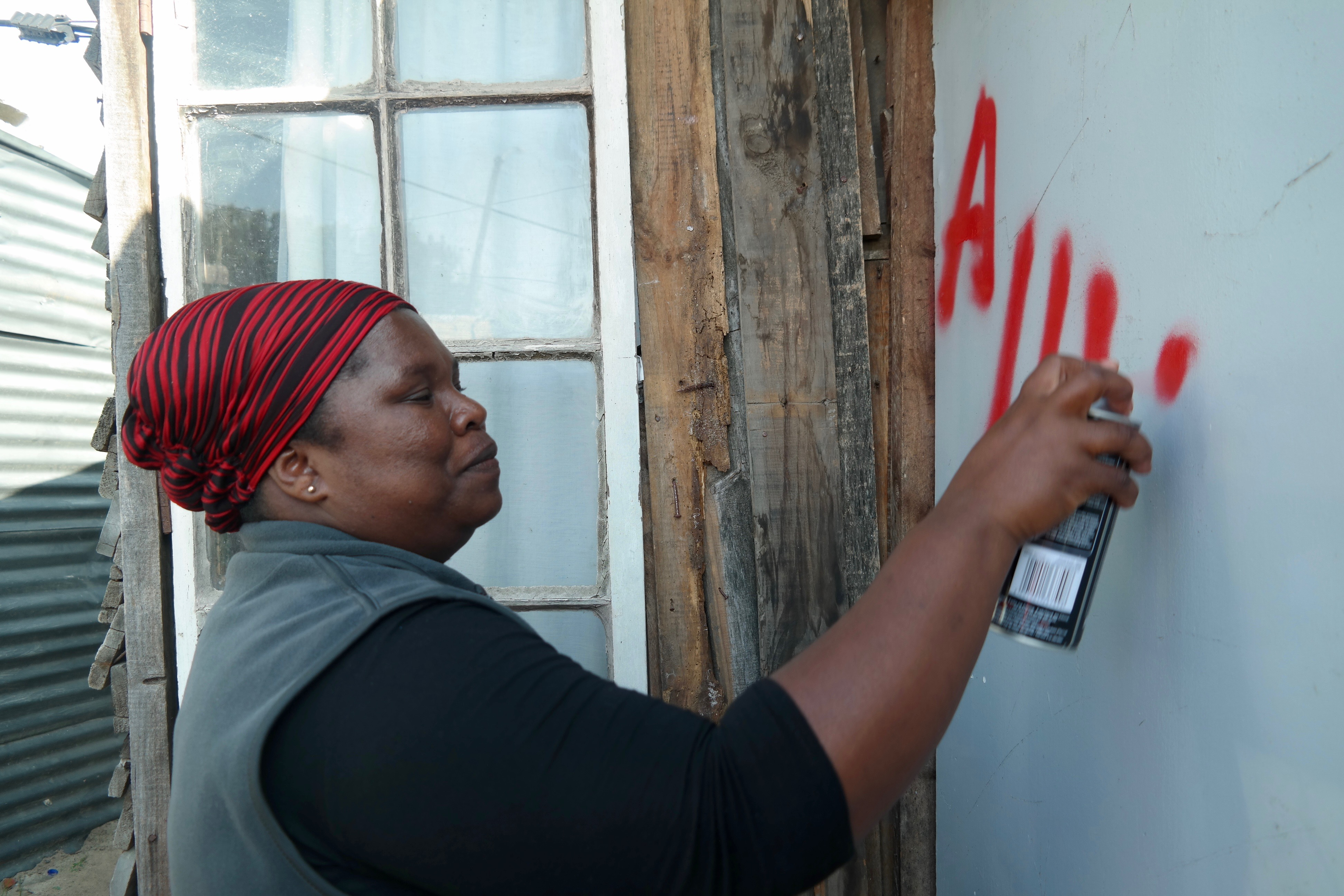 "Each shack in the community is spray-painted with a number. In this case, the number is preceded by ""A"" to refer to the section of the settlement, given Kosovo's large size."