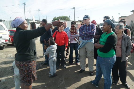 Community leader of TT Section, Site B Khayelitsha welcomes Somsook to her settlement