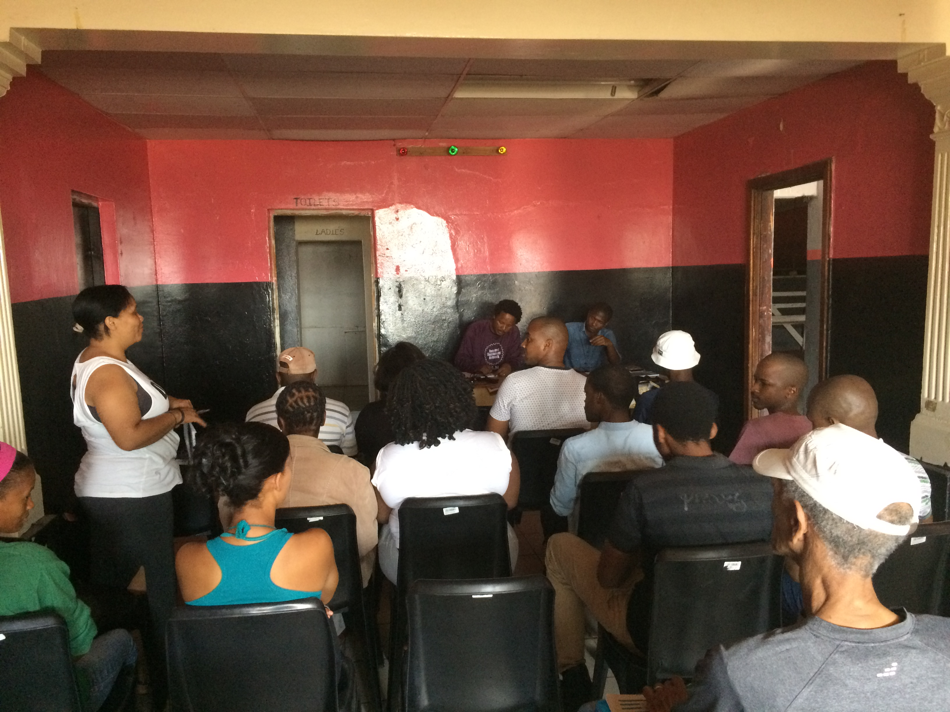 Informal settlement residents coming together to discuss community issues based on profiling that they conducted.