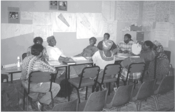 The Joe Slovo community meets in 1997. Pictured in the white shirt on the left is community leader Evelyn Benekane.