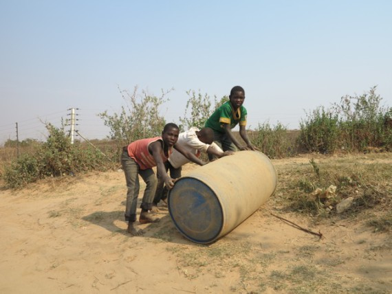 """Carrying"" water home in Chazanga, Lusaka"