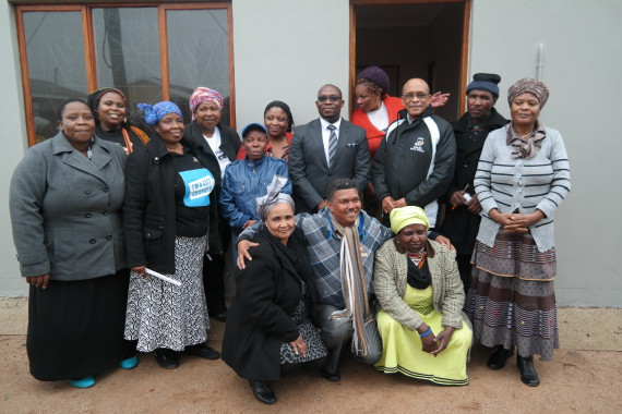 FEDUP savers, Norman Bless, Provincial Minister and Municipal representatives infront of Norman Bles' new house