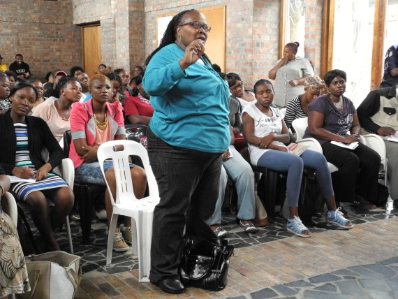 Alina speaks to fellow FEDUP members during savings mobilisation