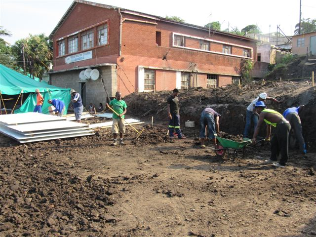 Mathambo residents begin reconstruction in the reblocked layout.
