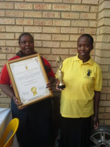 Jemina Nkoni (left) and Malefu Semonye (right) received a certificate and trophy for the third best performing saving network in the Free State